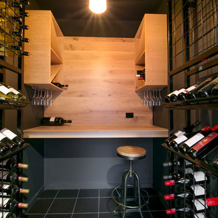 Design ideas for a small industrial wine cellar in Brisbane with ceramic flooring and storage racks.