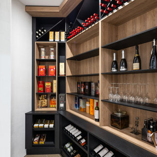 Photo of a contemporary wine cellar in Gold Coast - Tweed with diamond bins and beige floor.