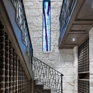 Inspiration pour une très grand cave à vin design avec des casiers losange et un sol bleu.