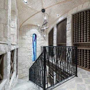 Diseño de bodega contemporánea, extra grande, con botelleros de rombos y suelo azul