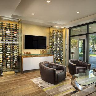 Immagine di una cantina moderna di medie dimensioni con portabottiglie a vista, pavimento con piastrelle in ceramica e pavimento grigio