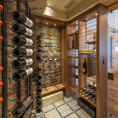 Inspiration for a large contemporary concrete floor and multicolored floor wine cellar remodel in Denver with display racks