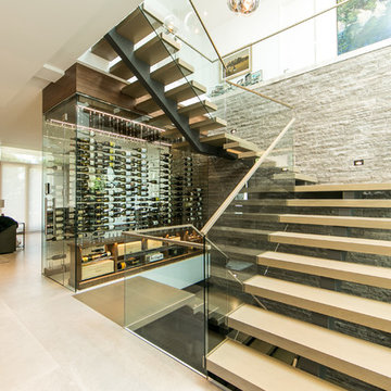 Contemporary Under-the-Stairs Wine Cellar featuring the Cable Wine System