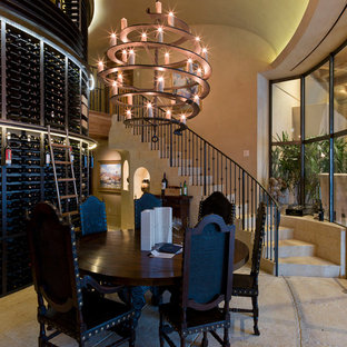Example of a tuscan concrete floor wine cellar design in Austin