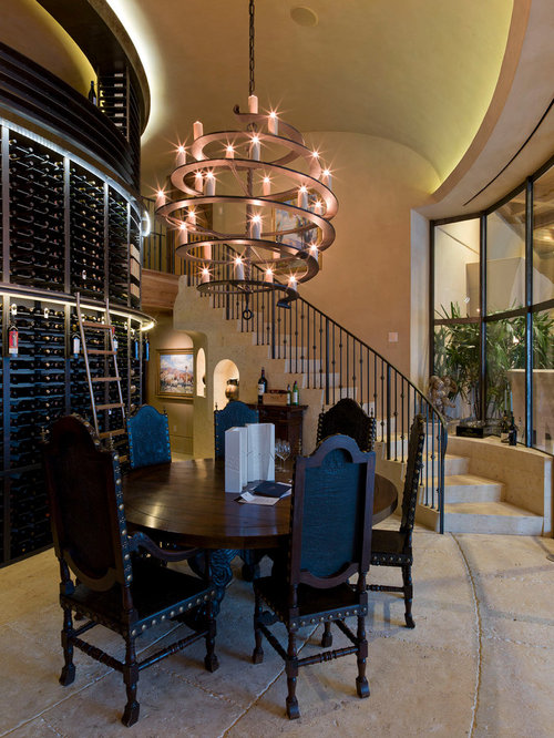 example of a trendy concrete floor wine cellar design in austin - Paul Ferrante Chandelier