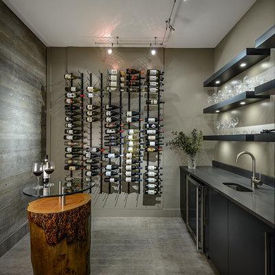 Wine cellar - contemporary concrete floor and gray floor wine cellar idea in Vancouver