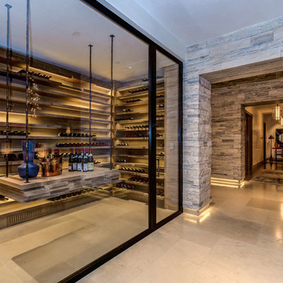 Inspiration for a large contemporary beige floor and porcelain tile wine cellar remodel in Philadelphia with storage racks