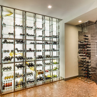 Design ideas for a contemporary wine cellar in Toronto with storage racks and cork flooring.