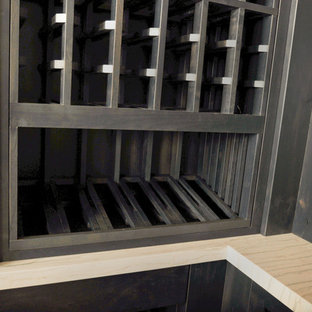 Inspiration for a mid-sized cottage concrete floor wine cellar remodel in San Diego with storage racks