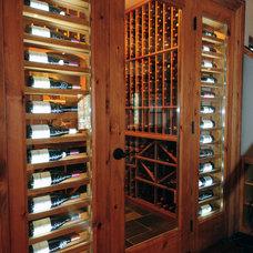 Rustic Wine Cellar by Kris Brigden Design Co., North Muskoka House Ltd.
