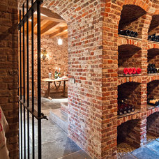 Traditional Wine Cellar by LEFEVRE INTERIORS