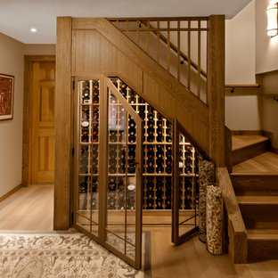 Example of a small classic light wood floor and brown floor wine cellar design in Burlington with storage racks
