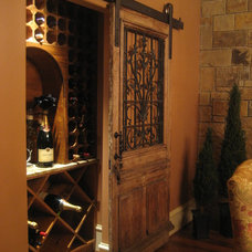 Mediterranean Wine Cellar by GABRIEL HOME BUILDERS INC