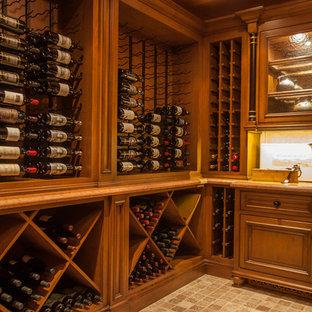 Foto på en mellanstor medelhavsstil vinkällare, med flerfärgat golv och vinställ med diagonal vinförvaring