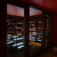 Modern Wine Cellar by Design Build Consultants Inc.