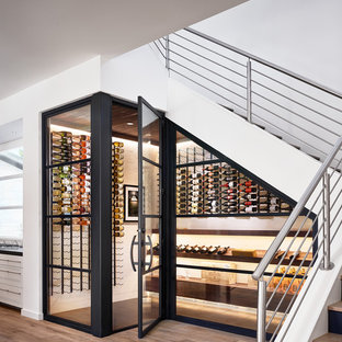 Example of a trendy beige floor wine cellar design in Austin with display racks