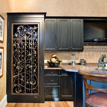 Custom Bar with Wrought Iron Cellar Door