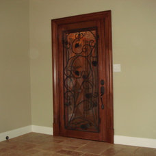 Traditional Wine Cellar by VV Contracting, Inc