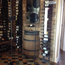 Traditional Wine Cellar by Bella Tile and Stone