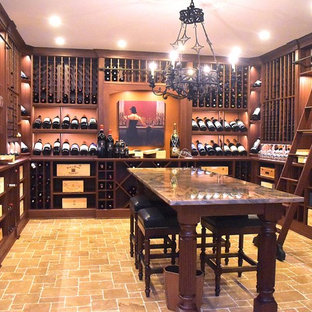 This is an example of an expansive traditional wine cellar in New York with travertine flooring, storage racks and beige floors.