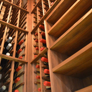 Design ideas for a medium sized country wine cellar in Orange County with display racks.