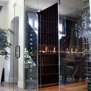 Mid-sized trendy medium tone wood floor wine cellar photo in Orange County with storage racks