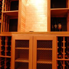 Traditional Wine Cellar by Heritage Vine Inc.