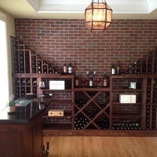 Réalisation d'une petit cave à vin champêtre avec des casiers losange.