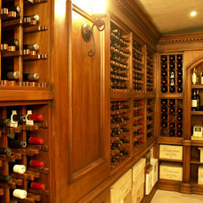 Traditional Wine Cellar by WL INTERIORS