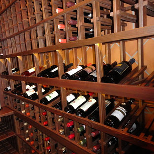 Photo of a small romantic wine cellar in San Diego with ceramic flooring and display racks.