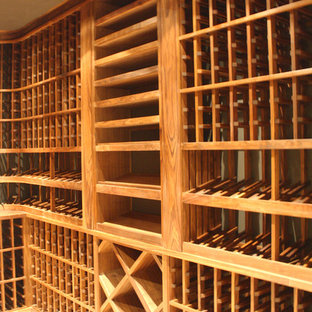 Design ideas for a medium sized traditional wine cellar in Los Angeles with medium hardwood flooring and storage racks.