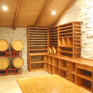 Design ideas for a large rustic wine cellar in Los Angeles with ceramic flooring and storage racks.
