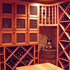 Traditional Wine Cellar by Mark Sweeden Construction