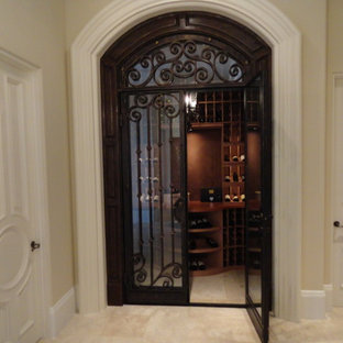 Example of a mid-sized classic ceramic floor wine cellar design in San Diego with display racks