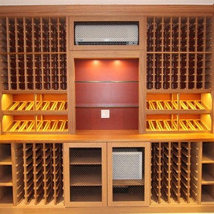 Inspiration for a medium sized classic wine cellar in New York with display racks, light hardwood flooring and beige floors.