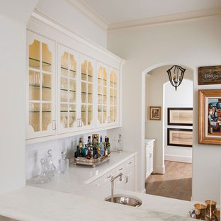 Inspiration for a timeless wine cellar remodel in Dallas