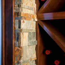 Mediterranean Wine Cellar by MCM Construction Inc