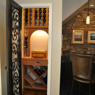 This is an example of a small bohemian wine cellar in Other with display racks.