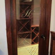 Traditional Wine Cellar by Fiducia Home Builders and Design, Inc.