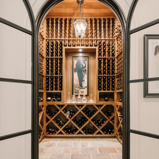Design ideas for a traditional wine cellar in Dallas with cube storage and beige floors.