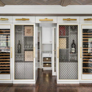 Inspiration for a mid-sized transitional medium tone wood floor and brown floor wine cellar remodel in Chicago with display racks