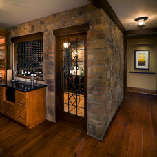 Traditional Wine Cellar by kbcdevelopments