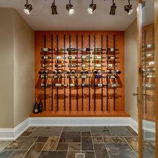 Transitional Wine Cellar by Geometra Design Ltd.