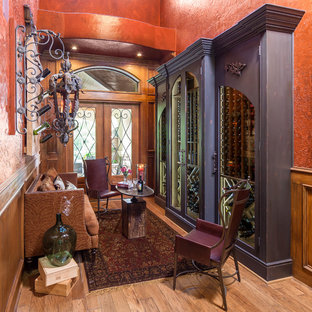 Inspiration for an eclectic wine cellar remodel in Houston