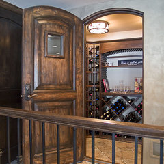 modern wine cellar by Schrader & Companies