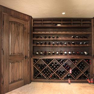 Inspiration för stora medelhavsstil vinkällare, med travertin golv och vinställ med diagonal vinförvaring