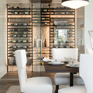 Photo of a small modern wine cellar in Los Angeles with display racks.