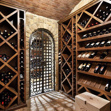 Traditional Wine Cellar by JAUREGUI Architecture Interiors Construction