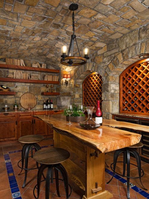 Rustic Terra Cotta Floor And Brown Floor Wine Cellar Idea In Detroit