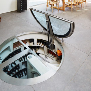 Small contemporary wine cellar in London with storage racks.